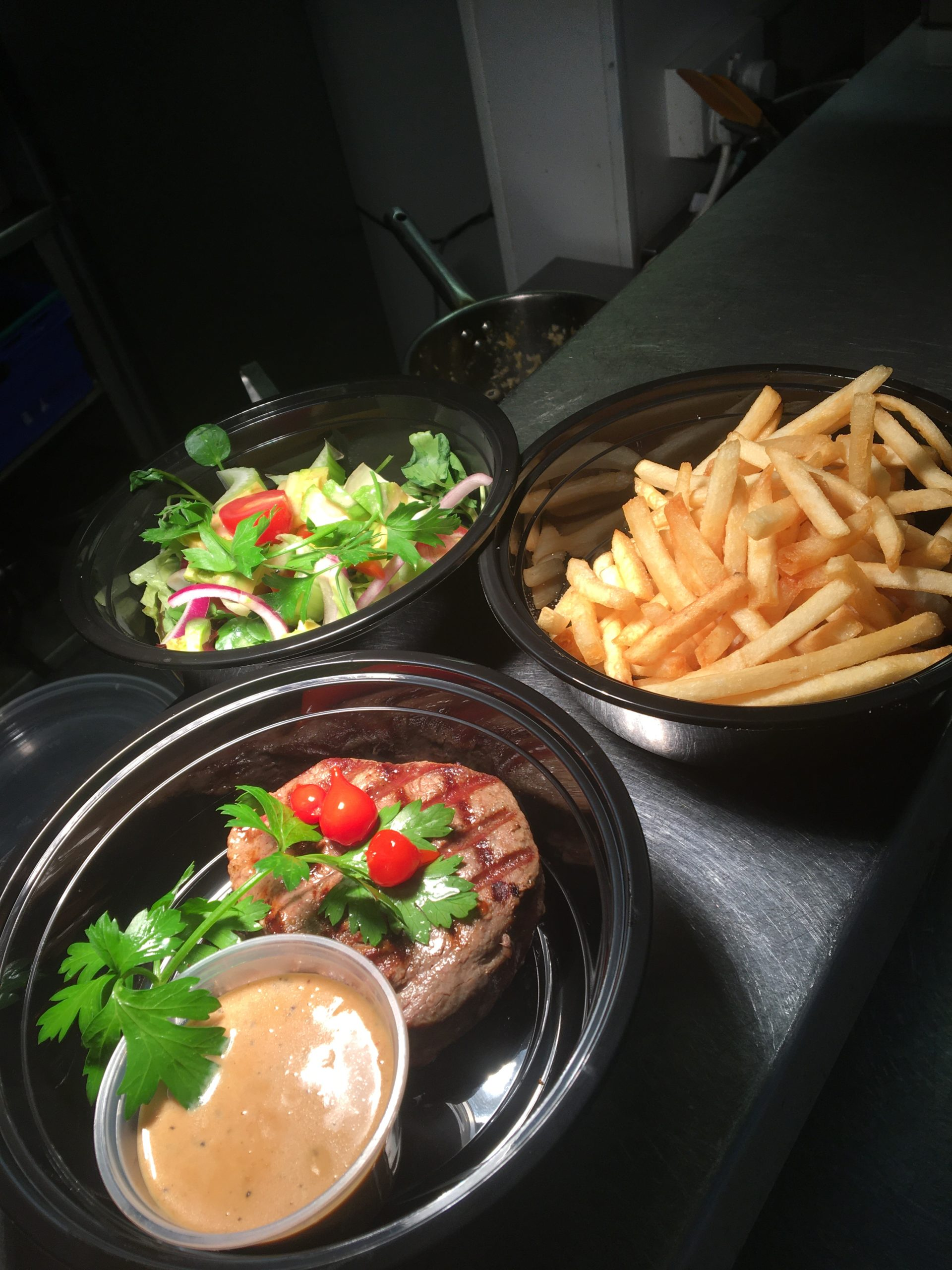 Fillet steak, fries and salad served with brandy and peppercorn sauce